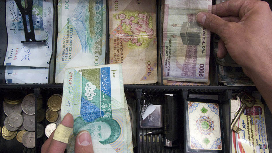 Storekeeper places money in drawer