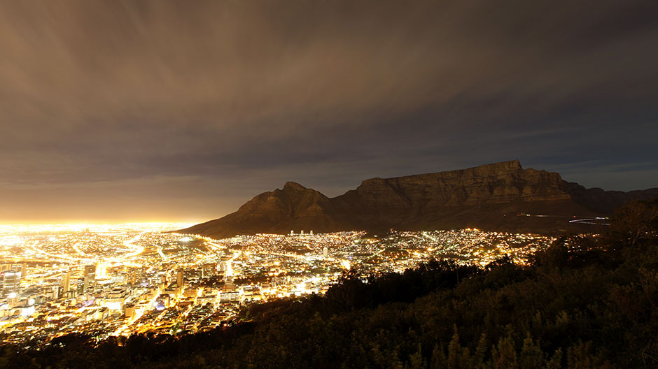 Cape Town lights up as dusk falls over the city's backdrop Table Mountain